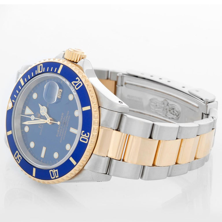 Rolex Submariner 2-Tone Steel & Gold Men's Watch 16613 - Automatic winding. Stainless steel case with gold rotating bezel with blue insert. Blue dial . Rolex oyster bracelet. Pre-owned with custom box.