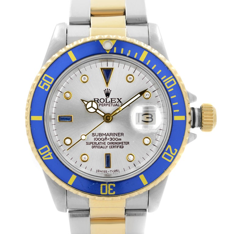 Pre Owned Rolex Submariner 40mm 18k Yellow Gold Steel Serti Dial Automatic Watch 16803. This Beautiful Timepiece was Produced in 1987. Powered by Mechanical (Automatic) Movement And Features: Round Stainless Steel Case With a Stainless Steel & 18k