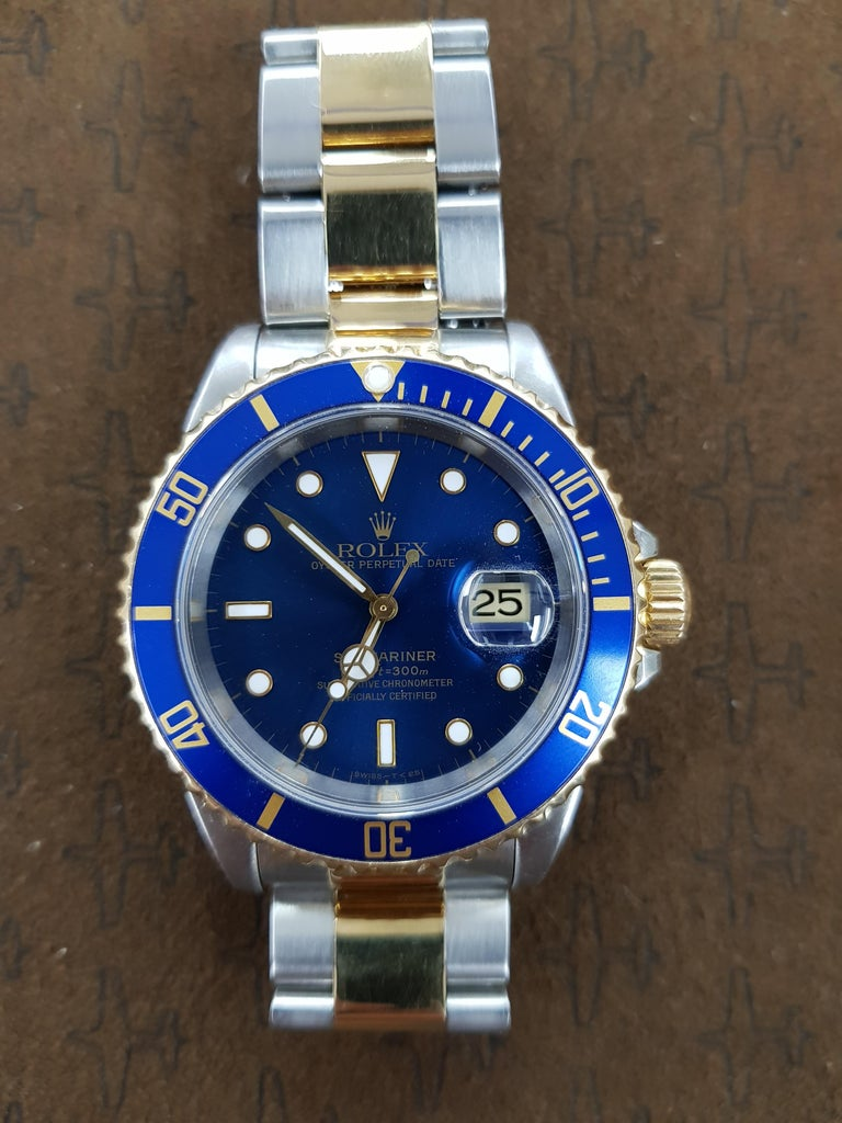 Bi-metal Rolex Submariner (pre ceramic) 40mm dial. Combines yellow gold with stainless steel. This watch comes with full Rolex certification.