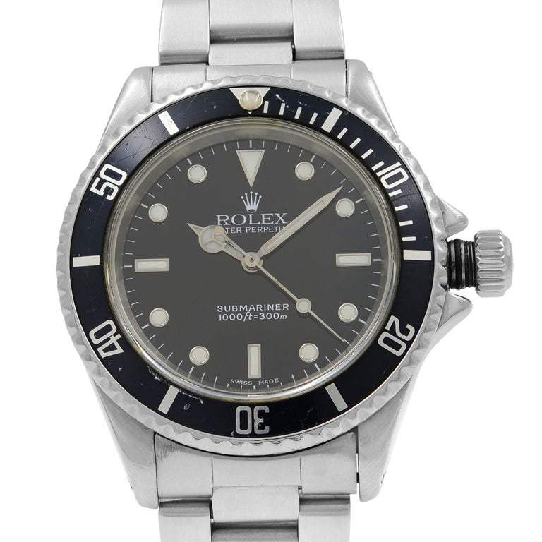 This pre-owned Rolex Submariner  14060M is a beautiful men's timepiece that is powered by mechanical (automatic) movement which is cased in a stainless steel case. It has a round shape face, no features dial and has hand sticks & dots style markers.