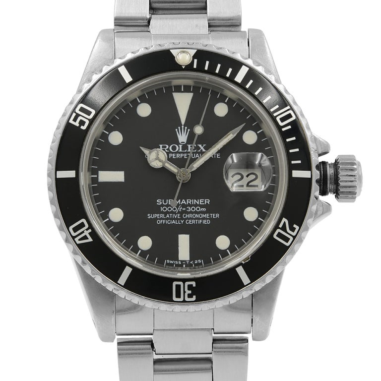 This pre-owned Rolex Submariner  16800 is a beautiful men's timepiece that is powered by an automatic movement which is cased in a stainless steel case. It has a round shape face, date dial and has hand sticks & dots style markers. It is completed