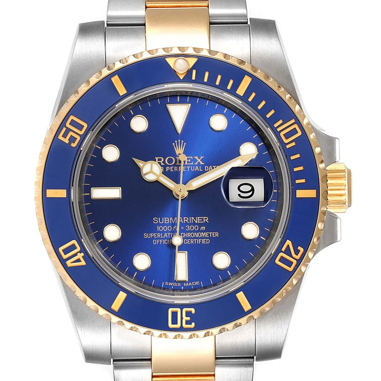 Rolex Submariner Blue Dial Steel Yellow Gold Mens Watch 116613 Box Card. Officially certified chronometer self-winding movement. Stainless steel and 18k yellow gold case 40.0 mm in diameter. Rolex logo on a crown. Ceramic blue Ion-plated special