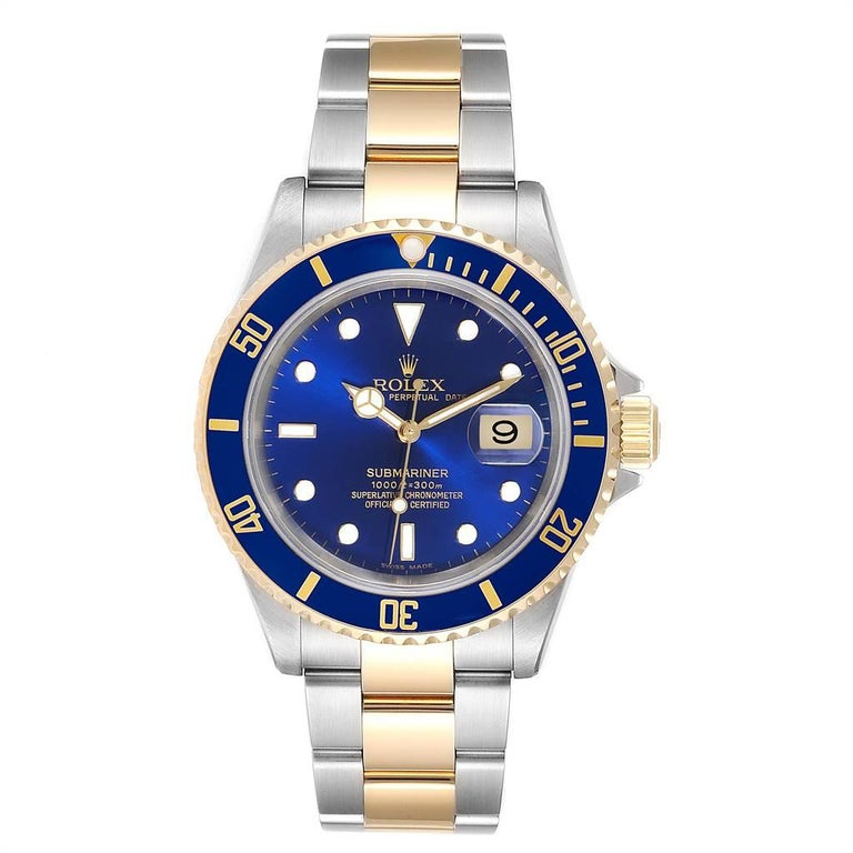Rolex Submariner Blue Dial Steel Yellow Gold Mens Watch 16613 Box Papers. Officially certified chronometer self-winding movement. Stainless steel and 18k yellow gold case 40 mm in diameter. Rolex logo on a crown. Blue insert special time-lapse
