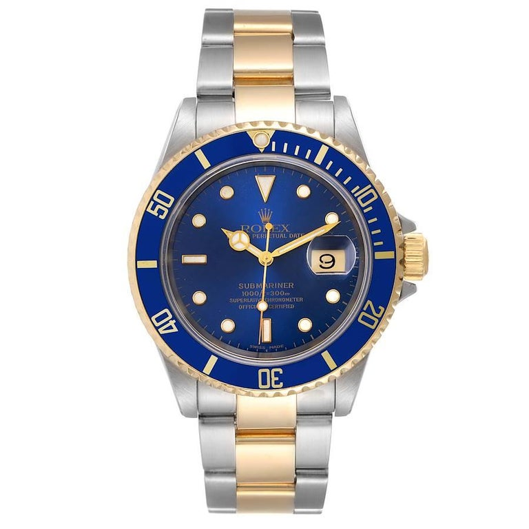 Rolex Submariner Blue Dial Steel Yellow Gold Mens Watch 16613. Officially certified chronometer self-winding movement. Stainless steel and 18k yellow gold case 40 mm in diameter. Rolex logo on a crown. Blue insert special time-lapse unidirectional