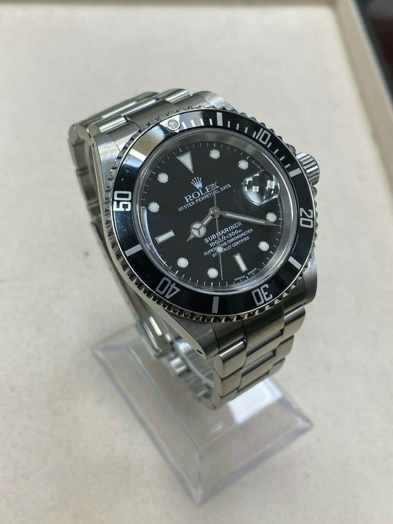 Style Number: 16110     Serial: K376***   Year: 2001     Model: Submariner     Case Material: Stainless Steel     Band: Stainless Steel     Bezel:  Black     Dial: Black     Face: Sapphire Crystal     Case Size: 40mm     Includes:   -Elegant Watch