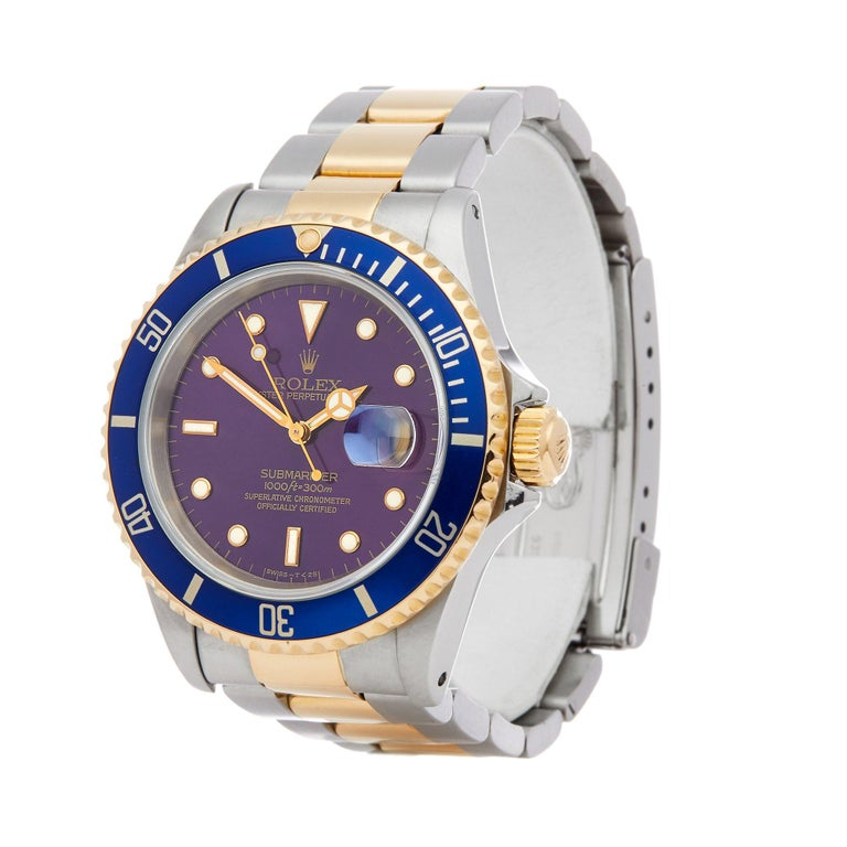 Xupes Reference: W007405 Manufacturer: Rolex Model: Submariner Model Variant: Date Model Number: 16613 Age: 01-03-1993 Gender: Men Complete With: Rolex Box & Guarantee Dial: Purple / Blue Other Glass: Sapphire Crystal Case Size: 40mm Case Material: