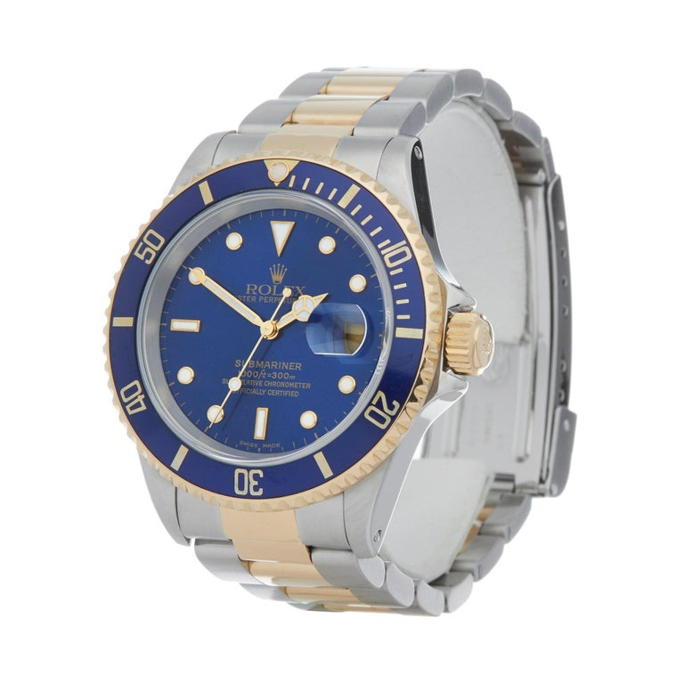 Xupes Reference: W007669 Manufacturer: Rolex Model: Submariner Model Variant: Date Model Number: 16613 Age: 36800 Gender: Men Complete With: Rolex Box, Manuals, Guarantee, Calendar Card, Card Holder & Swing Tag Dial: Blue Other Glass: Sapphire