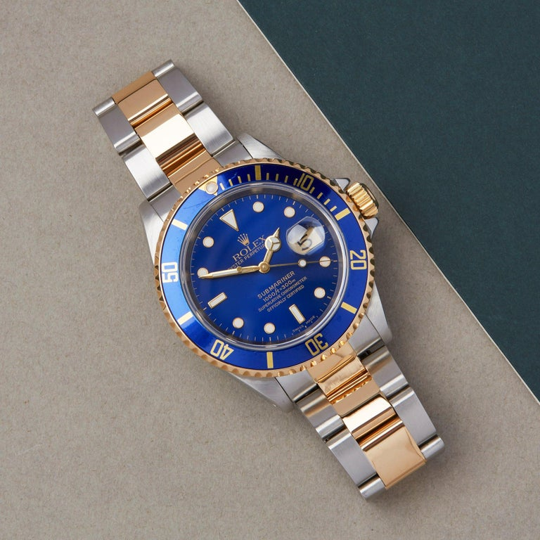 Xupes Reference: W007676 Manufacturer: Rolex Model: Submariner Model Variant: Date Model Number: 16613 Age: 37203 Gender: Men Complete With: Rolex Box, Manuals, Guarantee, Calendar Card, Card Holder & Swing Tag Dial: Blue Other Glass: Sapphire