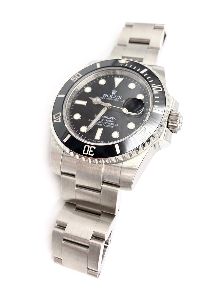 The iconic Rolex Submariner Date Watch 116610LN Stainless steel 40mm case Ebony black dial with cyclops date lens at 3 o'clock Black rotatable bezel in ceramic - officially known as Cerachrom 904L Oystersteel bracelet Hour markers and hands made of