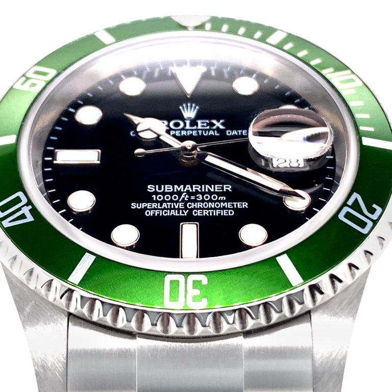 Beautiful condition Rolex Submariner Date with Green Anniversary Edition Bezel.  40mm Stainless Steel case.  Scratch resistant sapphire crystal.  Black dial with Superluminova hands and hour markers. Stainless Steel Oyster Bracelet with Oysterlock