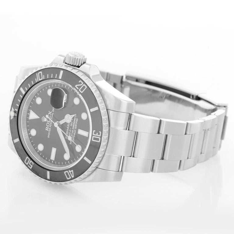 Rolex Submariner Men's Stainless Steel Watch 116610 - Automatic winding, 31 jewels, pressure proof to 1,000 feet. Stainless steel case with time-lapse Cerachrom bezel . Black dial with luminous markers; date at 3 o'clock. Stainless steel and Oyster