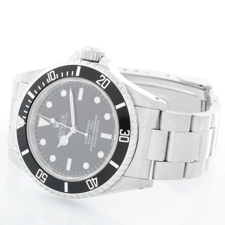 Rolex Submariner Men's Stainless Steel Watch (no-date) 14060 - Automatic winding. Stainless steel case (40mm diameter). Black dial with luminous hour markers. Stainless steel Oyster bracelet with flip-lock clasp. Pre-owned box and books.