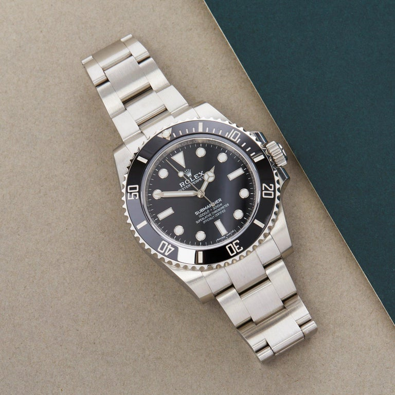 Xupes Reference: W007851 Manufacturer: Rolex Model: Submariner Model Variant: Non-Date Model Number: 114060 Age: 43770 Gender: Men Complete With: Rolex Box, Manuals, Swing Tag, Card Holder, Original Purchase Receipts & Guarantee Card  Dial: Black