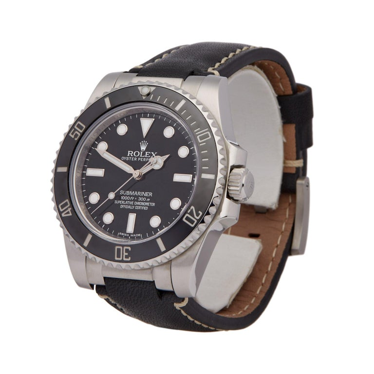 Xupes Reference: W007005 Manufacturer: Rolex Model: Submariner Model Variant: Non Date Model Number: 114060 Age: 07-03-2015 Gender: Men's Complete With: Box, Manuals, Guarantee Dial: Black Other Glass: Sapphire Crystal Case Size: 40mm Case Material: