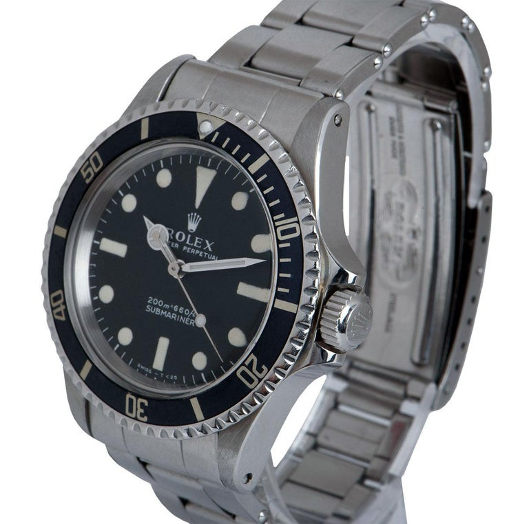 A 40 mm Stainless Steel Oyster Perpetual Submariner Non-Date Vintage Gents Wristwatch, matte black dial with hour markers, a stainless steel bi-directional rotating bezel with a black bezel insert, a stainless steel oyster bracelet with a stainless