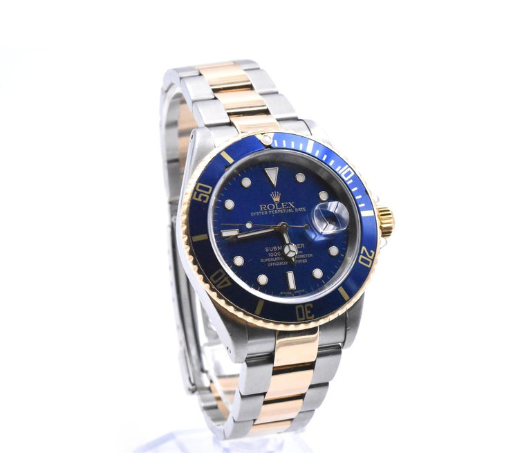 Rolex Submariner Two-Tone Blue Dial Watch Ref 16613  Movement: automatic  Function: hours, minutes, seconds, date Case: 40mm 18k yellow gold and stainless-steel case, sapphire crystal, 18k yellow gold bezel with blue insert, yellow gold screw-down