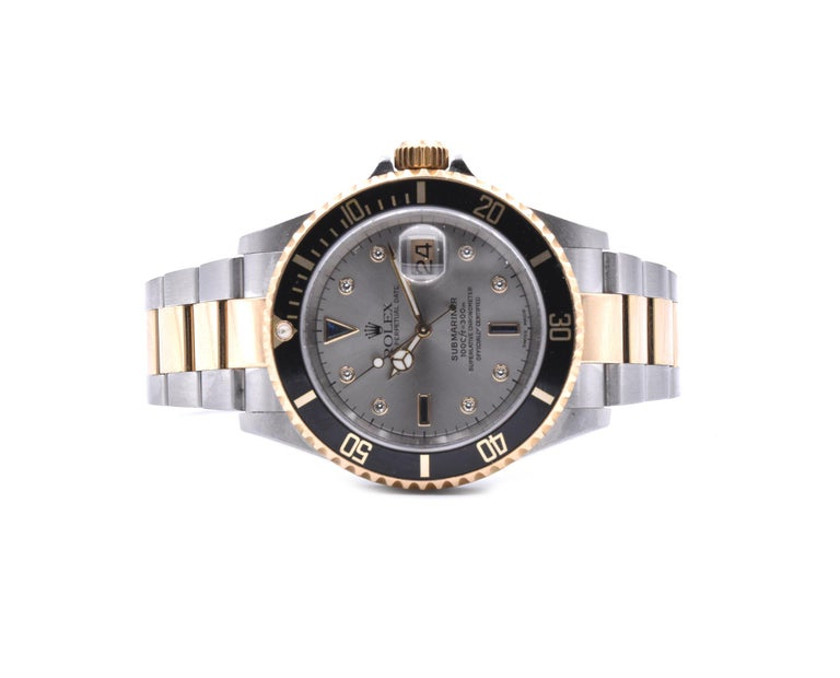 Rolex Submariner Stainless Steel & 18 Karat Yellow Gold Black Submariner with Gr In Excellent Condition For Sale In Scottsdale, AZ