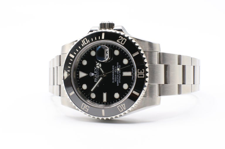 Rolex Submariner Stainless Steel Black Model 116610LN Box & Papers  Model: 116610LN Serial: Scrambled, card dated 2014 Stainless Steel Ceramic black bezel Black Dial Case Size: 40mm Movement: Automatic Box & Papers