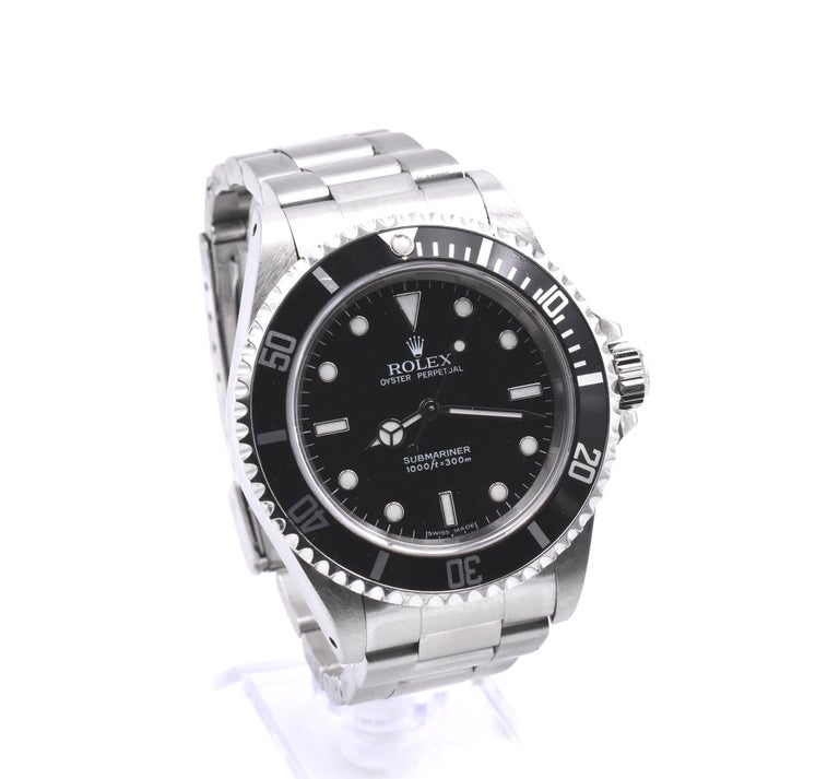 Movement: automatic Function: hours, minutes, seconds Case: 40mm stainless steel case, screw-down crown, unidirectional diver's bezel, scratch resistant sapphire crystal, waterproof to 300 meters Band: stainless steel oyster bracelet with folding