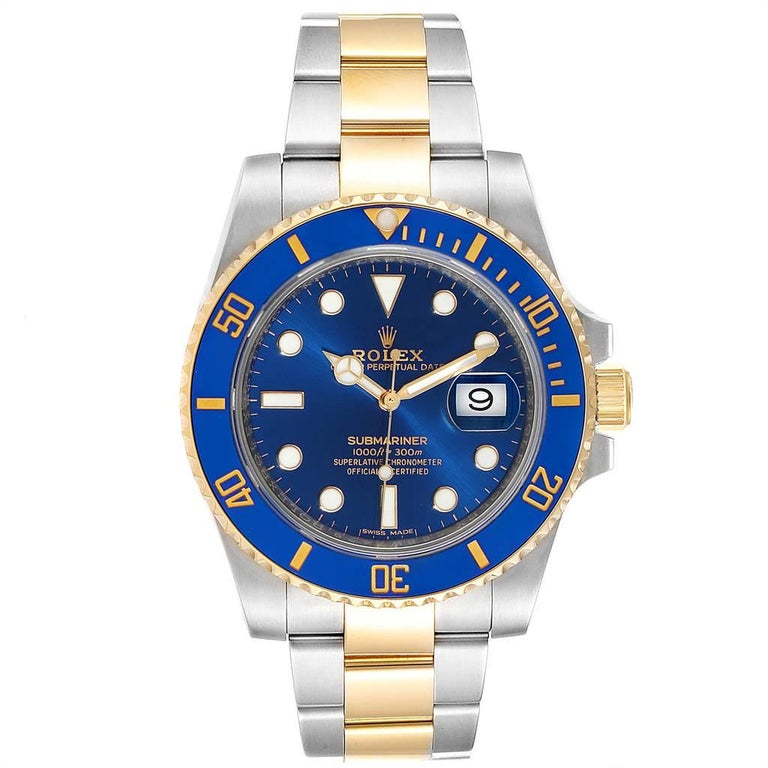 Rolex Submariner Steel 18K Yellow Gold Blue Dial Watch 116613. Officially certified chronometer self-winding movement. Stainless steel and 18k yellow gold case 40.0 mm in diameter. Rolex logo on a crown. Ceramic blue Ion-plated special time-lapse