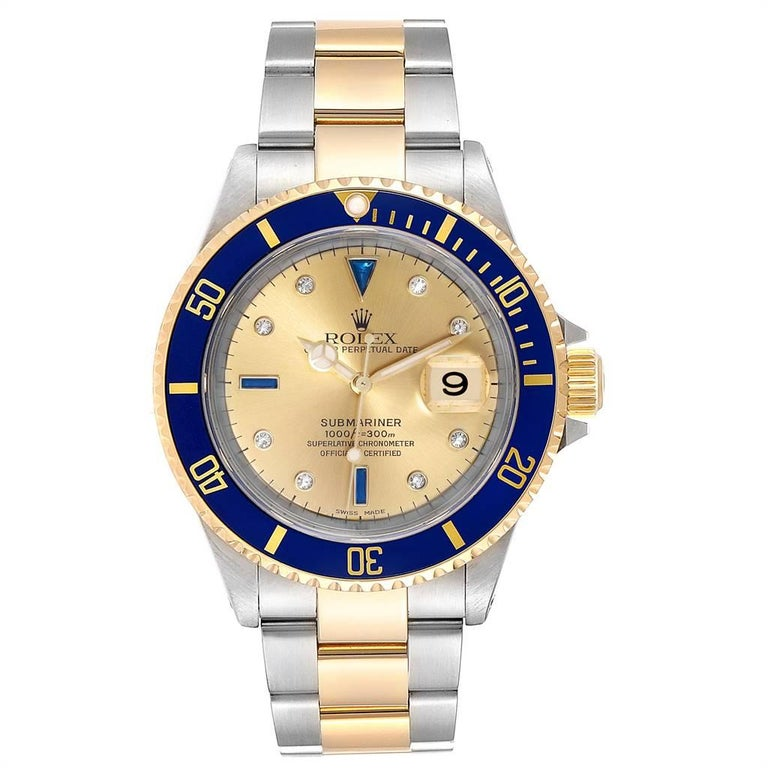 Rolex Submariner Steel Gold Diamond Sapphire Serti Dial Mens Watch 16613. Officially certified chronometer self-winding movement. Stainless steel and 18k yellow gold case 40 mm in diameter. Rolex logo on a crown. Blue insert special time-lapse
