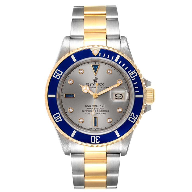 Rolex Submariner Steel Gold Slate Diamond Sapphire Serti Dial Watch 16803. Officially certified chronometer self-winding movement. Stainless steel and 18k yellow gold case 40.0 mm in diameter. Rolex logo on a crown. Blue insert special time-lapse