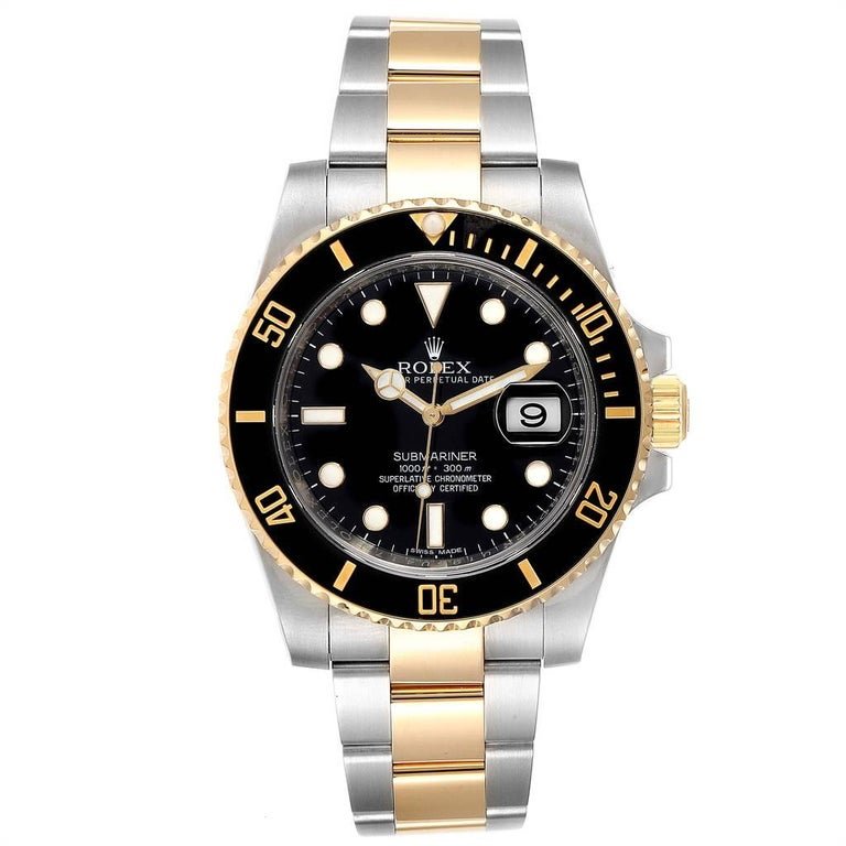 Rolex Submariner Steel Yellow Gold Black Dial Automatic Mens Watch 116613. Officially certified chronometer self-winding movement. Stainless steel and 18k yellow gold case 40 mm in diameter. Rolex logo on a crown. Ceramic black Ion-plated special