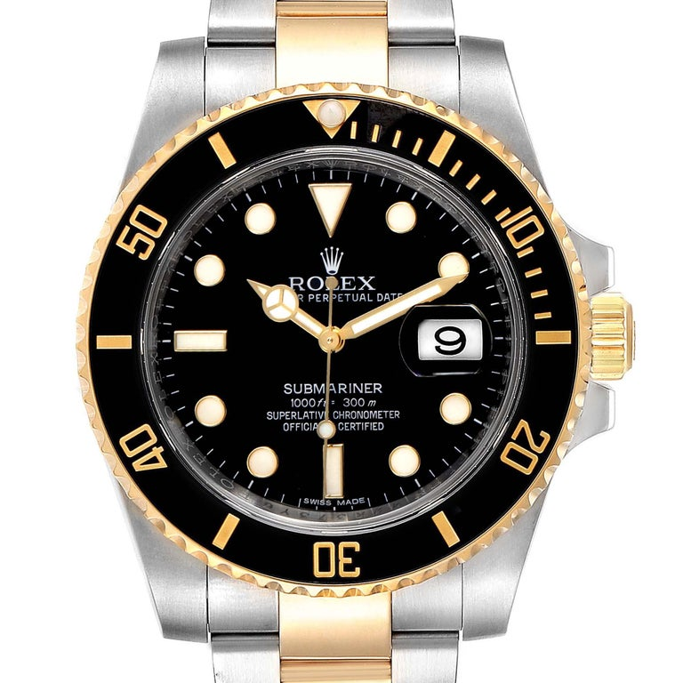 Rolex Submariner Steel Yellow Gold Black Dial Watch 116613 Box Card. Officially certified chronometer self-winding movement. Stainless steel and 18k yellow gold case 40 mm in diameter. Rolex logo on a crown. Ceramic black Ion-plated special