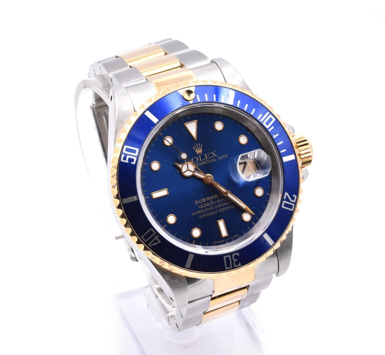 Designer: Rolex Movement: automatic  Function: hours, minutes, seconds, date Case: 40mm stainless-steel case, sapphire crystal, 18k yellow gold bezel with blue insert, yellow gold screw-down crown, waterproof to 100 meters Band: two-tone 18k yellow