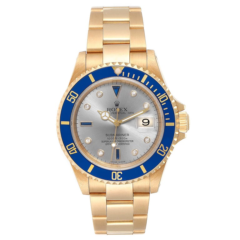 Rolex Submariner Yellow Gold Diamond Sapphire Serti Dial Watch 16618. Officially certified chronometer self-winding movement. 18k yellow gold case 40.0 mm in diameter. Rolex logo on a crown. Blue insert special time-lapse unidirectional rotating