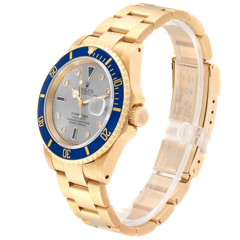 Rolex Submariner Yellow Gold Diamond Sapphire Serti Dial Watch 16618 In Excellent Condition For Sale In Atlanta, GA