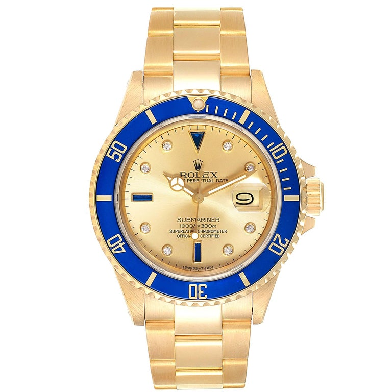 Rolex Submariner Yellow Gold Diamond Sapphire Serti Dial Watch 16808. Officially certified chronometer self-winding movement. 18k yellow gold case 40.0 mm in diameter. Rolex logo on a crown. Blue insert special time-lapse unidirectional rotating
