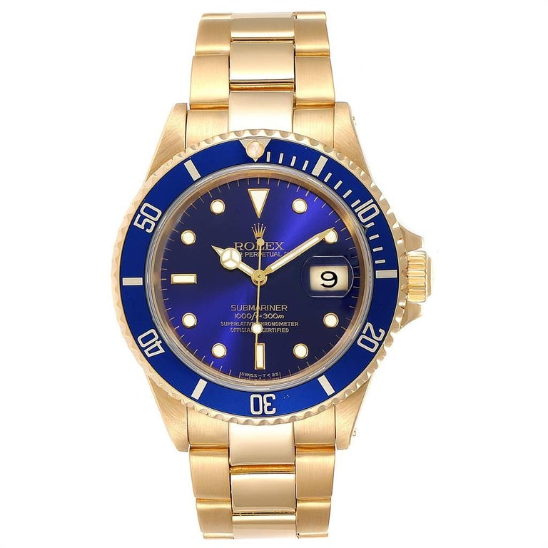 Rolex Submariner Yellow Gold Purple Dial 40mm Mens Watch 16618. Officially certified chronometer self-winding movement. 18k yellow gold case 40.0 mm in diameter. Rolex logo on a crown. Blue insert special time-lapse unidirectional rotating bezel.