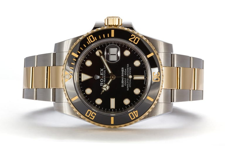 We are pleased to offer this 2019 Rolex Mens Two Tone Submariner 116613LN. It features a 40mm stainless steel case with black dial, 18k yellow gold bezel with black ceramic insert, engraved inner bezel, scrambled serial number, stainless steel and