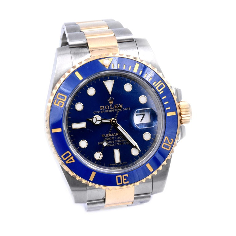 Movement: automatic Function: hours, minutes, seconds, date Case: round 40mm stainless steel case with blue ceramic 18k yellow gold diving bezel, sapphire protective crystal, screw-down crown, water resistant to 300 meters Band: stainless steel and
