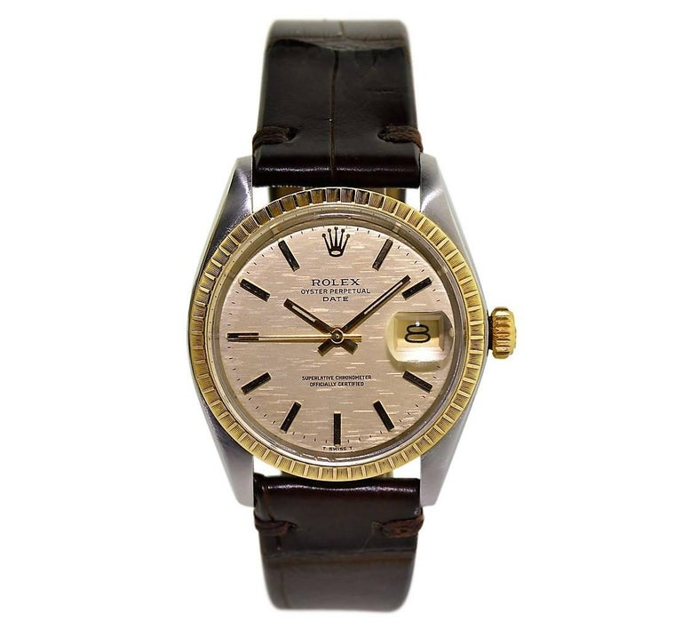 FACTORY / HOUSE: Rolex Watch Company STYLE / REFERENCE: Oyster Perpetual Date / Ref. 1505 METAL / MATERIAL: Stainless Steel and 14Kt. Yellow Gold CIRCA: 1971 / 1972 DIMENSIONS: 41mm X 35mm MOVEMENT / CALIBER: Perpetual Winding / 26 Jewels / Cal.