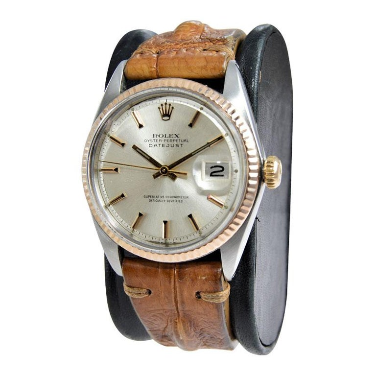 FACTORY / HOUSE: Rolex Watch Company STYLE / REFERENCE: Datejust / 1601 METAL / MATERIAL: Two Tone Steel and Rose Gold CIRCA / YEAR: 1970's DIMENSIONS / SIZE: 44mm X 38mm MOVEMENT / CALIBER: Perpetual Winding / 26 Jewels / 1570 DIAL / HANDS: