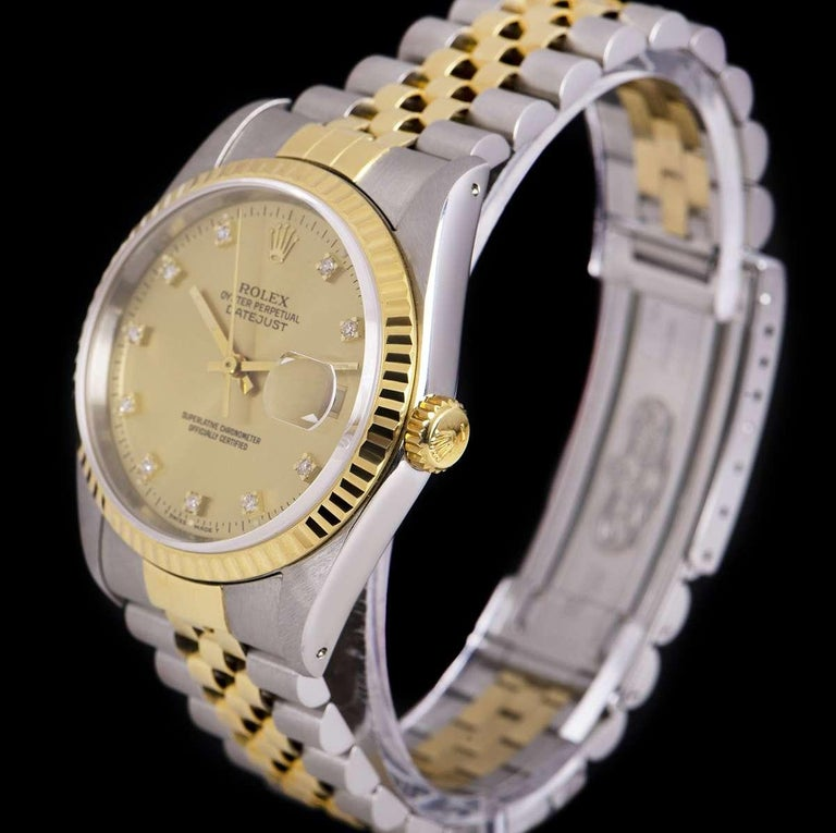 An Unworn Stainless Steel and 18k Yellow Gold Oyster Perpetual Datejust NOS Gents Wristwatch, champagne dial with 10 applied round brilliant cut diamond hour markers, date at 3 0'clock, a fixed 18k yellow gold fluted bezel, a stainless steel and 18k