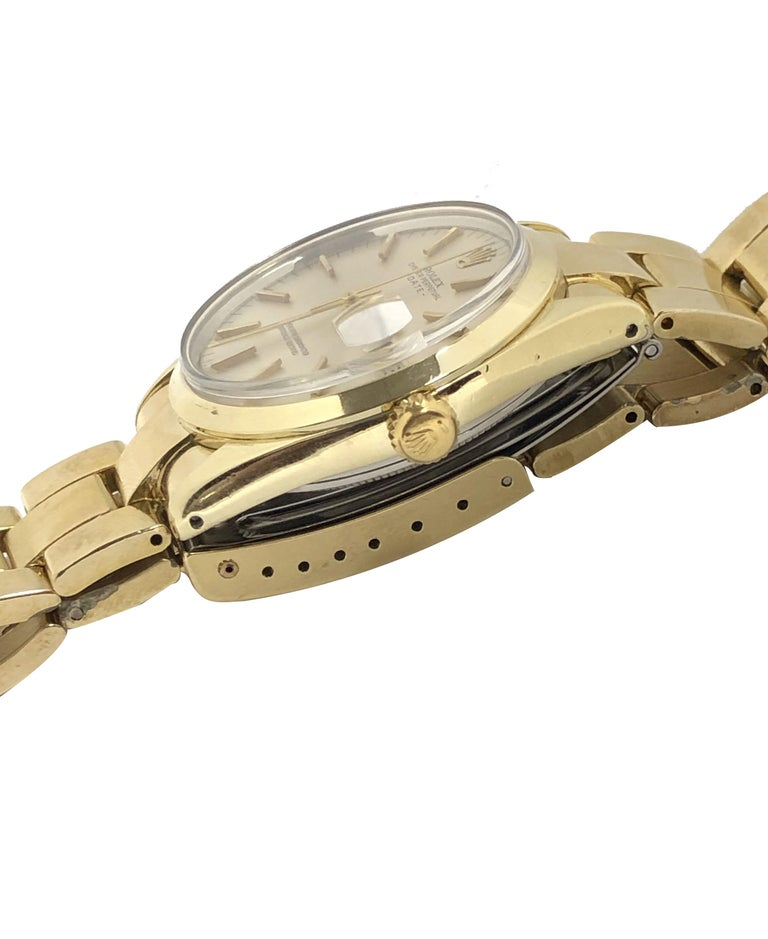 Circa 1972 Rolex Reference 1550 Date Wrist Watch, 34 M.M. 2 piece Gold Shell Oyster case with Steel back, Caliber 1570 Automatic Self Winding movement Near mint Silver Satin Dial with raised Gold Markers, sweep seconds hand and a Calendar window at