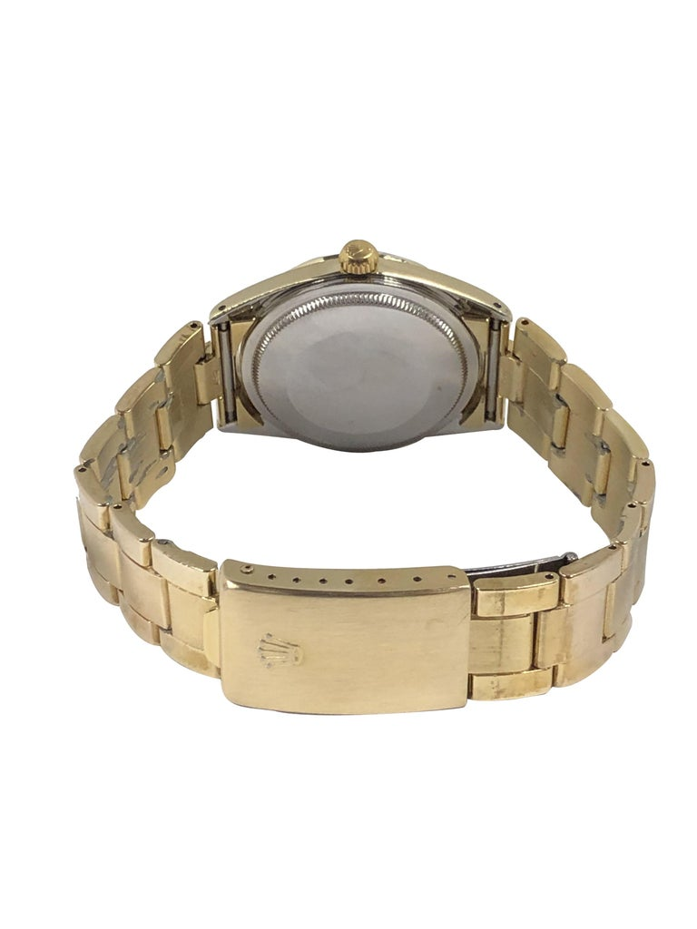 Women's or Men's Rolex Vintage Gold Shell Date Model Automatic on Gold Shell Oyster Bracelet