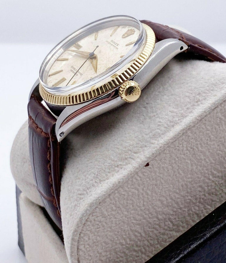 Style Number: 6567     Serial: 325***    Model: Oyster Perpetual     Case Material: Stainless Steel     Band: Custom Brown Leather Strap     Bezel:  14K Yellow Gold     Dial: Ivory - Original Natural Patina      Face: Acrylic      Case Size: 34mm