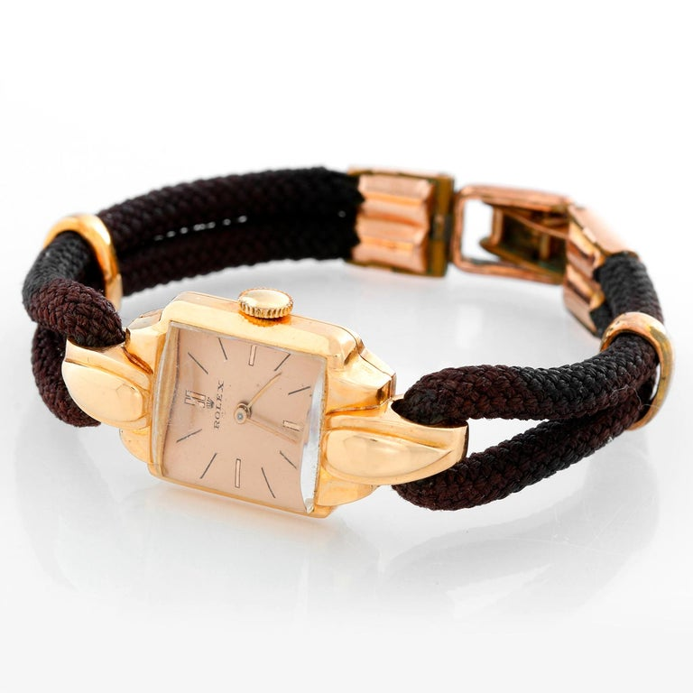 Rolex Vintage Rose Gold Ladies Dress Watch - Manual winding . Rose gold case ( 17 x 35 mm ) . Salmon colored dial with stick hour markers . Double rope strap; will fit up to a 6 inch wrist . Pre-owned with custom box. Circa 1940-'s-1950's .