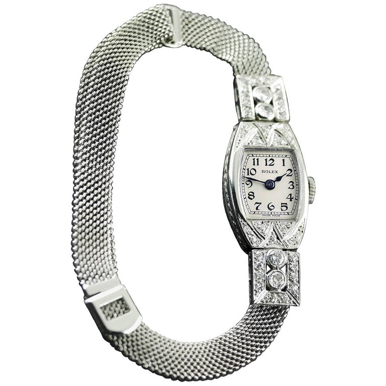 An Art Deco vintage wristwatch by Rolex made in 1926.  18 carat white gold case, set with diamonds with engraved