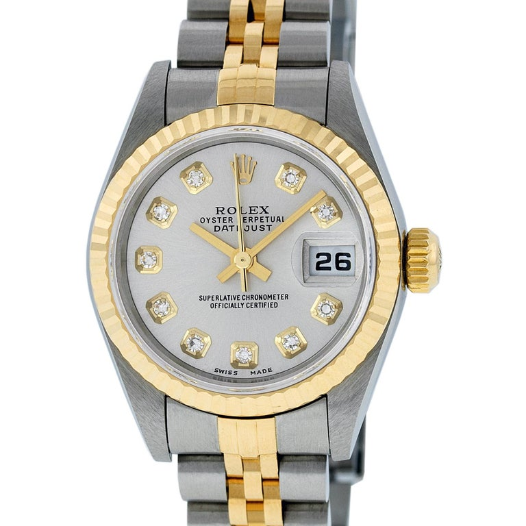 WATCH DESCRIPTION   BRAND : Rolex MODEL : Datejust CASE SIZE : 26mm CASE : Rolex Stainless Steel Case GENDER : Women's  WATCH FEATURES   DIAL : Rolex Professionally Refinished Silver Dial set with aftermarket Genuine Round (VVS H Color) Diamond Hour