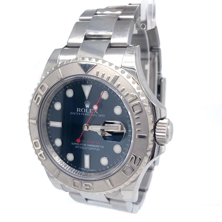 Rolex Yachtmaster 116622 Men Watch. 40mm Stainless Steel case. Platinum Bidirectional bezel. Blue dial with Luminous Steel hands and index, dot hour markers. Minute markers on the outer dial. Date display at the 3 o'clock position. Stainless Steel