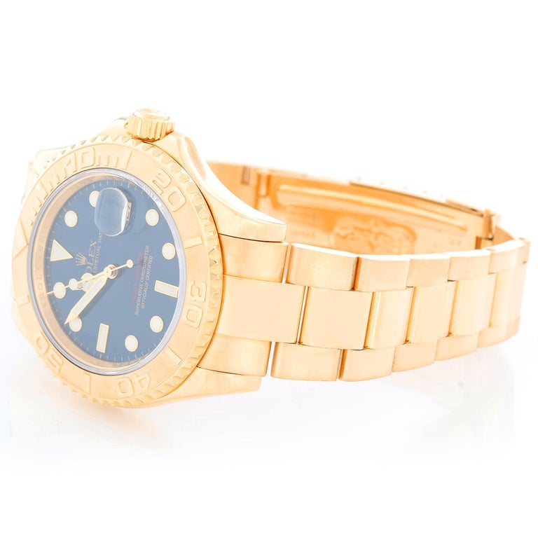 Rolex Yacht-Master Men's 18k Yellow Gold Watch 16628 -  Automatic winding, 31 jewels, Quickset, sapphire crystal. 18k yellow gold case (40mm diameter). Blue dial with luminous style hour markers; date at 3 o'clock. 18k yellow gold Oyster bracelet