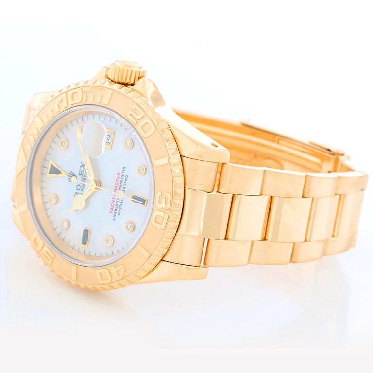 Rolex Yacht-Master Men's 18k Yellow Gold Watch Mother of Pearl 16628 - Automatic winding, 31 jewels, Quickset, sapphire crystal. 18k yellow gold case and bezel  (40mm diameter). Mother of Pearl with diamond and sapphire hour markers. 18k yellow gold
