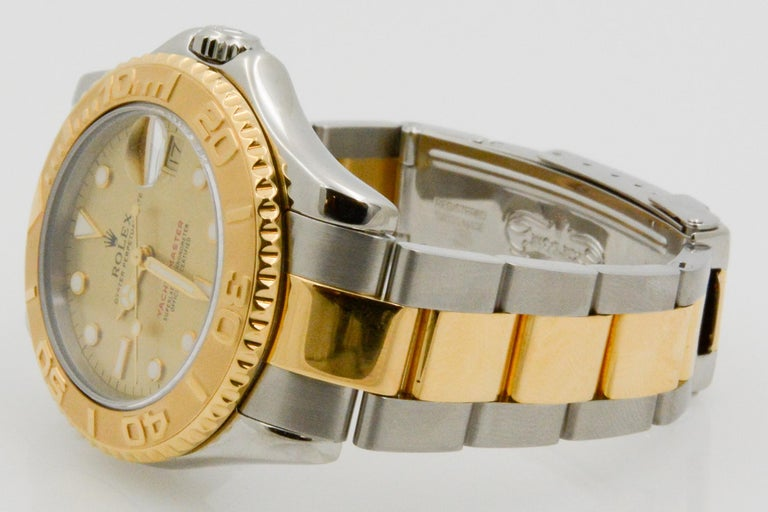 This ladies Rolex Yacht-Master steel and 18k yellow gold watch has a champagne and sapphire crystal index with auto movement. The watch is paired with an oyster bracelet.
