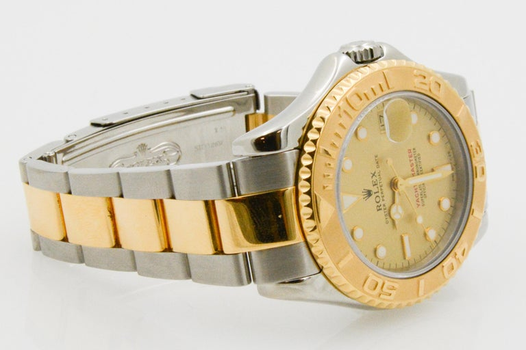 Rolex Yacht-Master Steel 18 Karat Yellow Gold and Champagne Ladies Watch 68623 In Good Condition In Dallas, TX