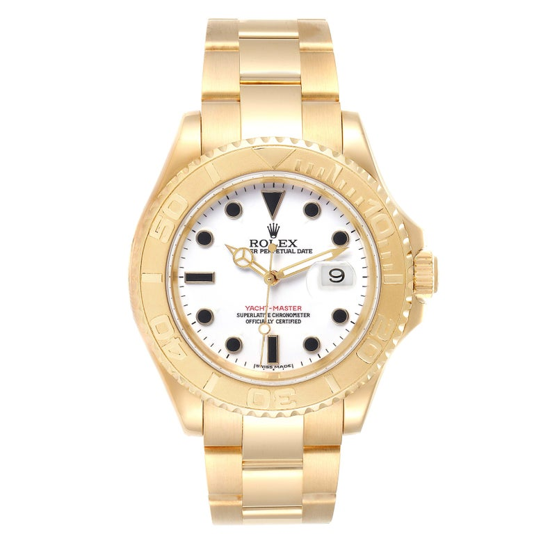 Rolex Yachtmaster 40 Yellow Gold White Dial Mens Watch 16628 Box Papers. Officially certified chronometer self-winding movement. Rhodium-plated, oeil-de-perdrix decoration, straight-line lever escapement, freesprung monometallic balance adjusted to